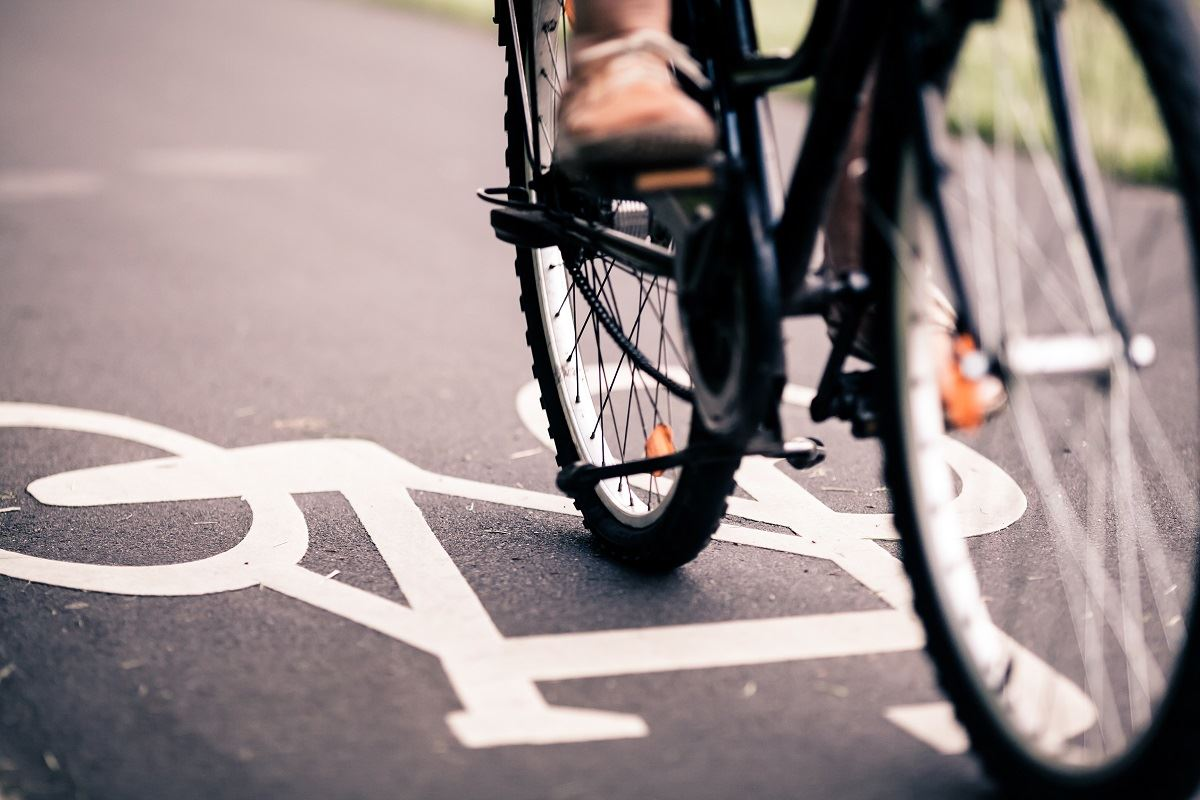 photo of a bicycle riding on a street