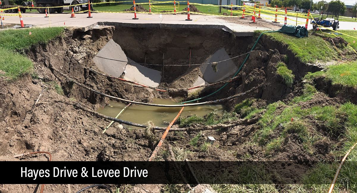photo of sink hole at Hayes Drive and Levee Drive