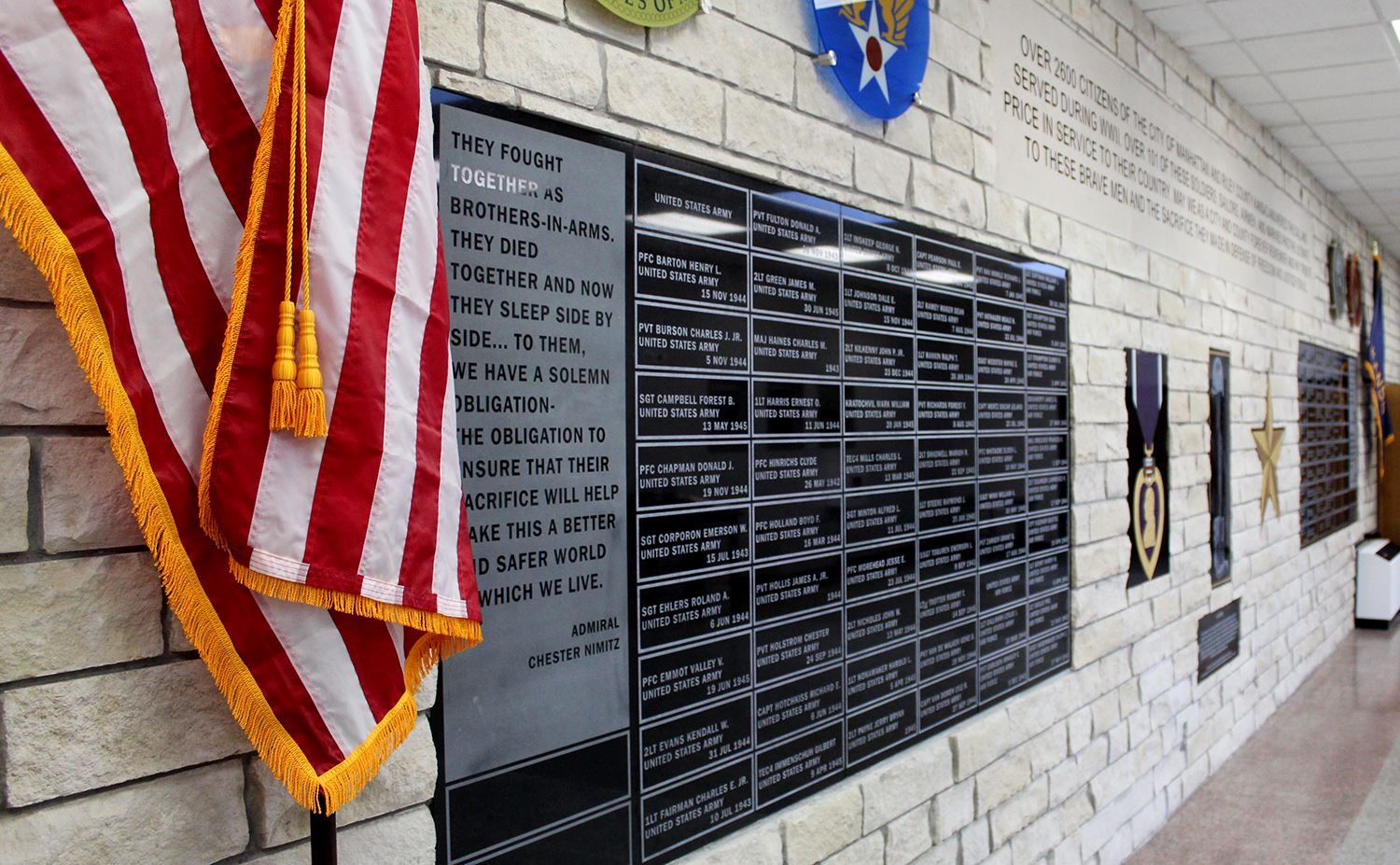 photo of the memorial wall outside Peace Memorial Auditorium