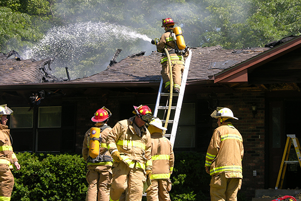 Crews battle a house fire